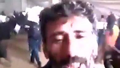 صورة اقتحام مستودع إغاثة من قبل نازحين في إدلب